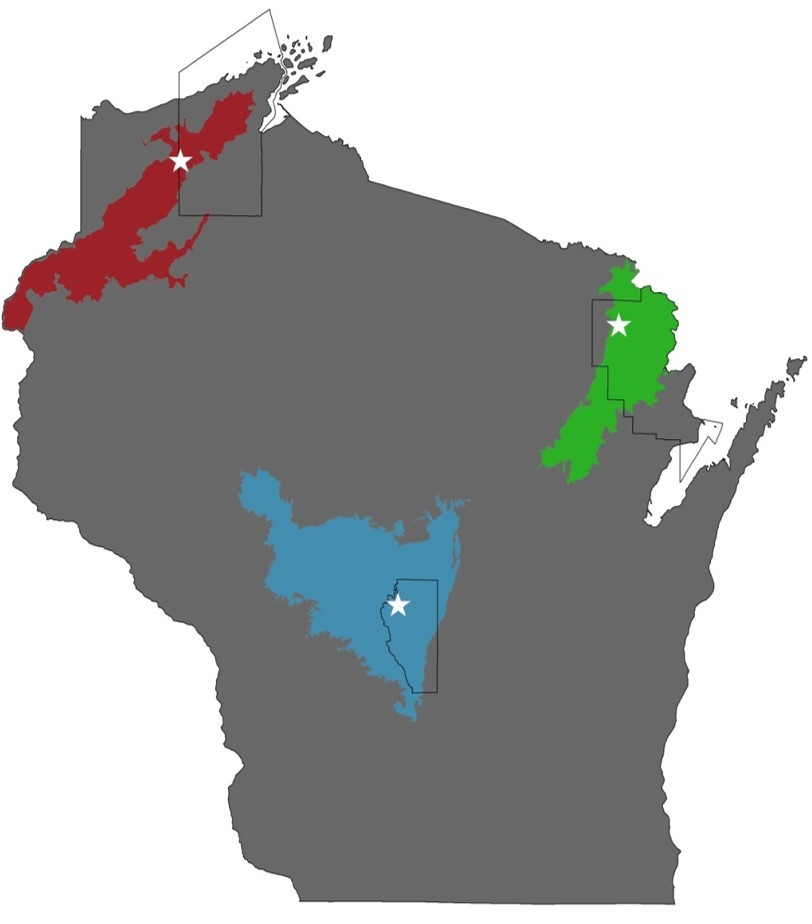 Figure 1 Ecological Regions where Kirtland's warblers breed in Wisconsin. In the Northwest Sands (Bayfield County; red) and the Northeast Sands (Marinette County; green), Kirtland's warblers breed in jack pine forests. In the Central Sands (Adams County; blue), Kirtland's warblers breed in in red pine dominated plantations.
